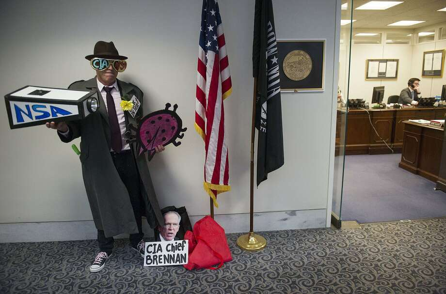 "Tighe Barry prepares to enter Sen. Dianne Feinstein's office in Washington, part of a Code Pink protest to ""expose her two-faced stance on spying."" Photo: Jim Watson, AFP/Getty Images"