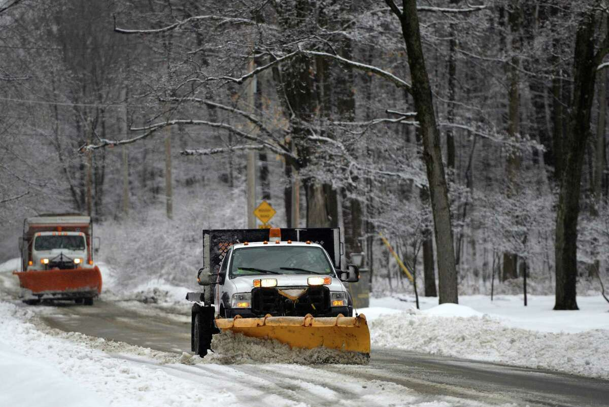 Saratoga City road crews stay ahead of the storm as they remove snow on upper Broadway near Skidmore College Wednesday afternoon, March 12, 2014, as a late winter storm hits Saratoga Springs, N.Y. (Skip Dickstein / Times Union)