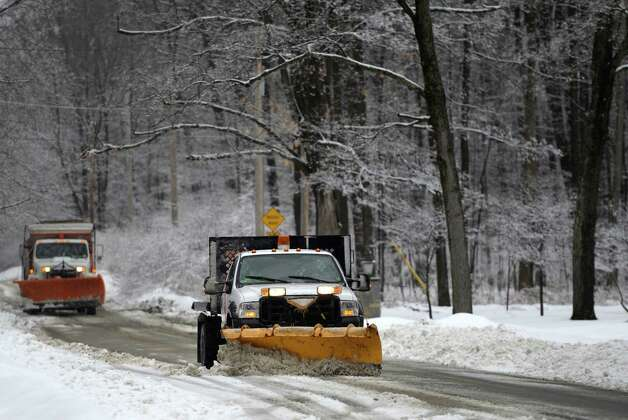 Saratoga City road crews stay ahead of the storm as they remove snow on upper Broadway near Skidmore College Wednesday afternoon, March 12, 2014, as a late winter storm hits  Saratoga Springs, N.Y.       (Skip Dickstein / Times Union) Photo: SKIP DICKSTEIN / 00026108A