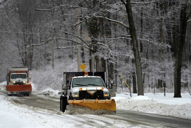 Saratoga City road crews stay ahead of the storm as they remove snow on upper Broadway near Skidmore