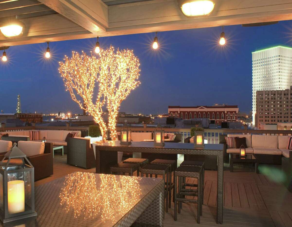 From the Tremont House Hotel's Rooftop Bar in Galveston, night views stretch from the harbor to the Gulf.
