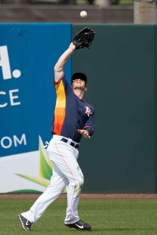 Robbie Grossman catches a fly ball in the sun. Photo: Rob Foldy, Getty Images