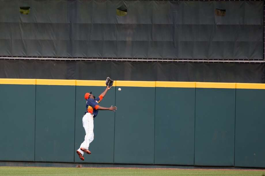 Dexter Fowler misses catching a fly ball. Photo: Rob Foldy, Getty Images