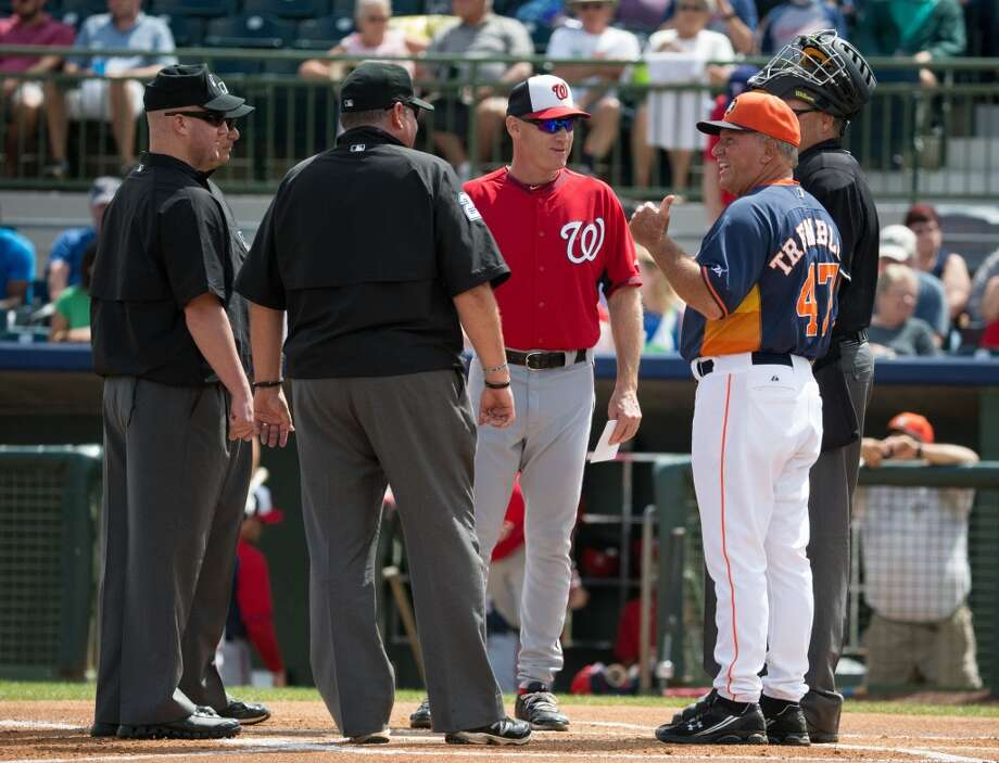 The Nationals' Matt Williams and Dave Trembley meet at home plate before the game. Photo: Rob Foldy, Getty Images