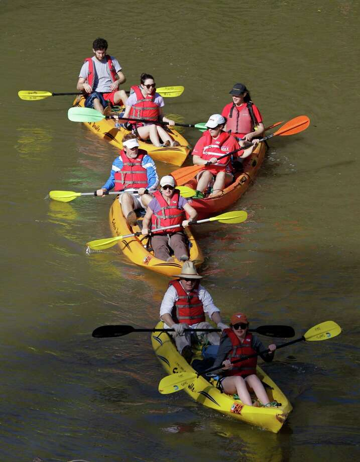People paddle along during the Buffalo Bayou Regatta  Saturday, March 16, 2013 in Houston. At least 500 boats are participating in the 15 mile race.  (Melissa Phillip / Houston Chronicle) Photo: Melissa Phillip, Staff / © 2013  Houston Chronicle