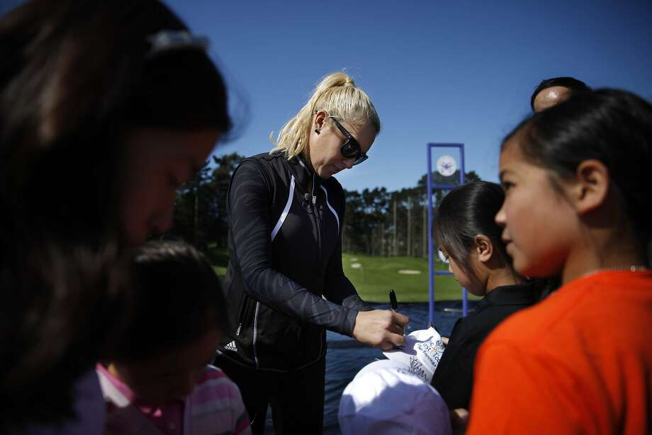 Natalie Gulbis greets fans at media day Monday for next month's Swinging Skirts LPGA Classic at Lake Merced. Photo: Lea Suzuki, The Chronicle