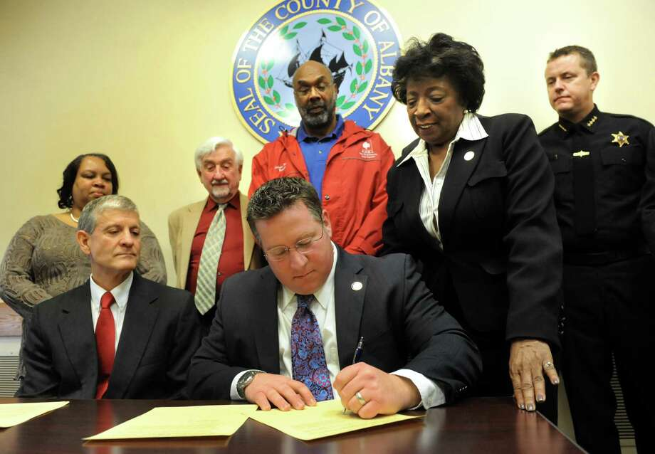 County Executive Dan McCoy, center, signs an executive order and directive to examine and report on the expansion of oil processing activities and its impact on public health and safety on Wednesday, March 12, 2014, at the Albany County office building in Albany, N.Y. (Cindy Schultz / Times Union) Photo: Cindy Schultz / 00026115A