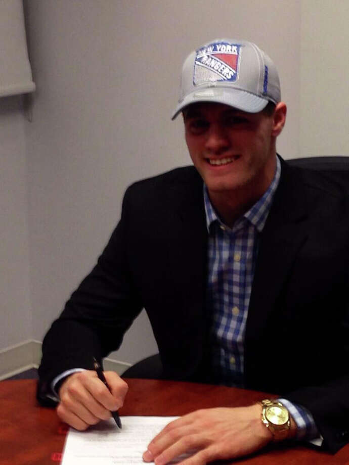 Stamford native Ryan Haggery signs a contract with the New York Rangers Wednesday. Photo: Contributed Photo, New York Rangers/Contributed Pho / Stamford Advocate Contributed