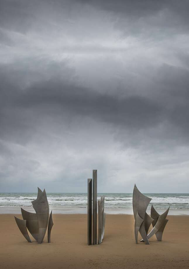 "Anilore Banon's ""Les Braves"" sculpture honors the soldiers that landed on Omaha Beach in 1944. Normandy, France, is marking the 70th anniversary of D-Day. Photo: Mark Harris, Getty Images"