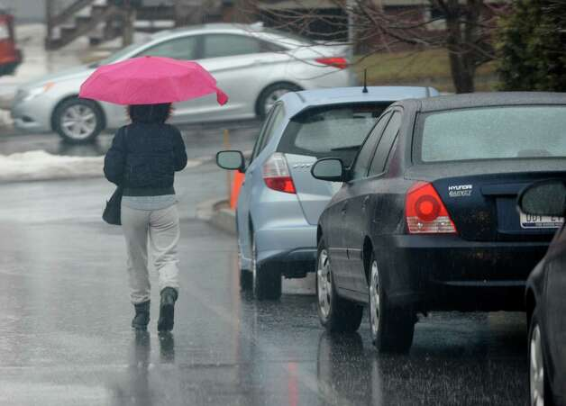 A woman walks with an umbrella near Hoosick St. on a rainy day Wednesday, March 12, 2014 in Troy, N.Y.  (Lori Van Buren / Times Union) Photo: Lori Van Buren / 00026108A