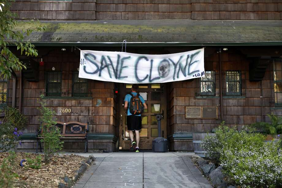 "A banner over the door at Cloyne Court reflects residents' reaction to a proposal to transform it into a ""substance-free"" academic residence. Photo: Michael Short, The Chronicle"