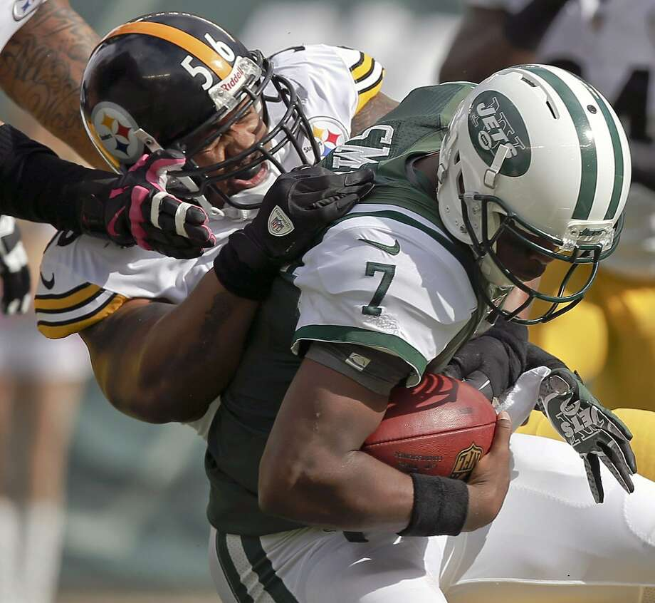 Steelers outside linebacker LaMarr Woodley (56) sacks Jets quarterback Geno Smith. Photo: Kathy Willens, Associated Press