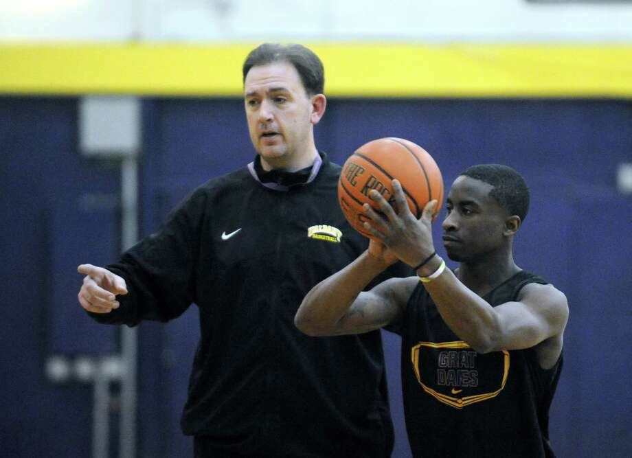 UAlbany head coach Will Brown runs his team through practice on Wednesday March 12, 2014 in Albany, N.Y. The UAlbany men's basketball team will play Stony Brook Saturday in the America East championship game. (Michael P. Farrell/Times Union) Photo: Michael P. Farrell / 00026117A