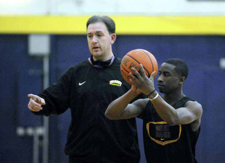 UAlbany head coach Will Brown runs his team through practice on Wednesday March 12, 2014 in Albany,