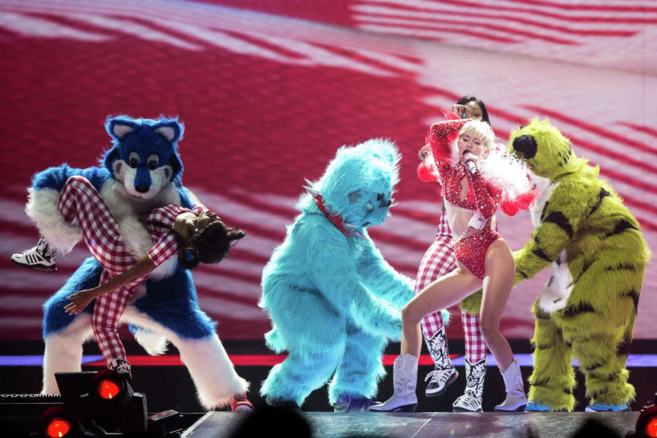 "Miley Cyrus performs at the Tacoma Dome, Feb. 16, 2014, in Tacoma, Wash. The concert was the first stop in the U.S. for her ""Bangerz"" tour. Photo: Thomas Soerenes, AP Photo/The News Tribune / The News Tribune"