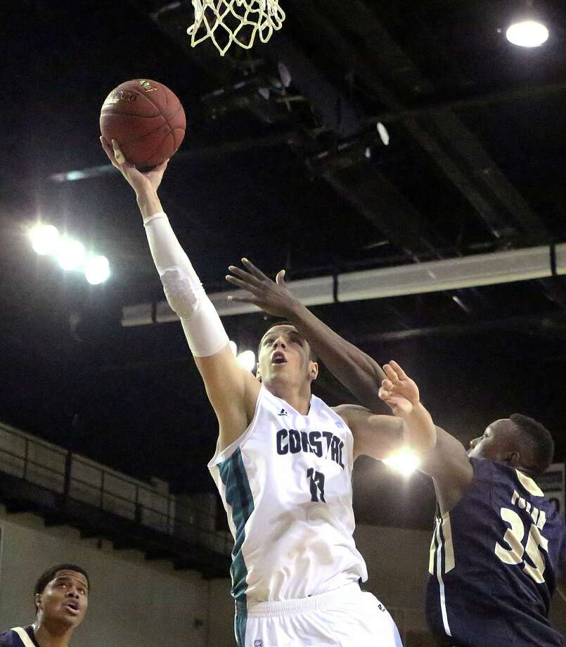 Coastal Carolina's Uros Ljeskovic (13) against Charleston Southern during an NCAA college basketball game in the quarterfinals of the Big South Conference men's tournament Friday, March 7, 2014, in Conway, S.C. (AP Photo/The Sun News, Janet Blackmon Morgan) Photo: Janet Blackmon Morgan, Associated Press / The Sun News