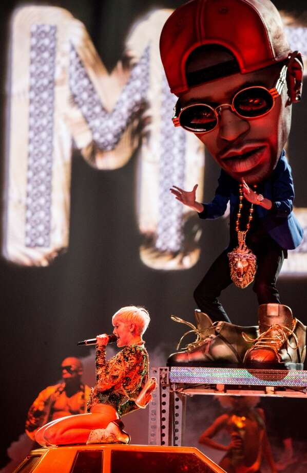 "Singer Miley Cyrus performs her ""Bangerz"" tour at the Honda Center on Feb. 20, 2014, in Anaheim, Calif. Photo: Christopher Polk, Getty Images"