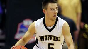 Wofford's Eric Garcia moves the ball up the court during the first half of the NCAA college basketball championship game of the Southern Conference tournament against Western Carolina in Asheville, N.C., Monday, March 10, 2014. (AP Photo/Adam Jennings)