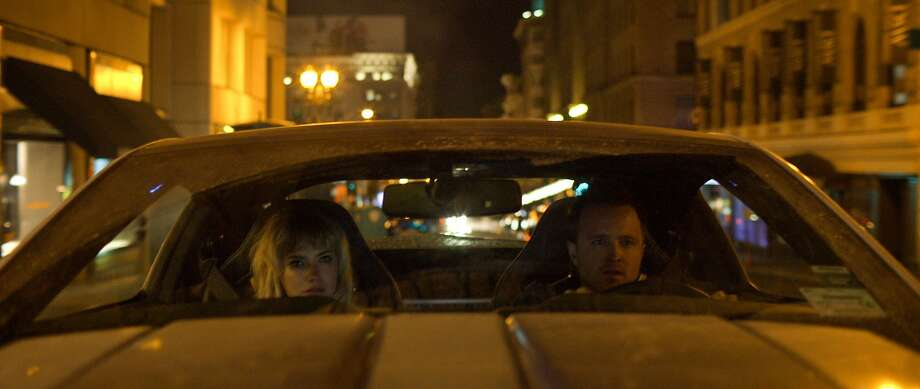 "Tobey Marshall (Aaron Paul) and Julia Maddon (Imogen Poots) have less than 45 hours to race from New York to California in ""Need for Speed."" Photo: Walt Disney Pictures"