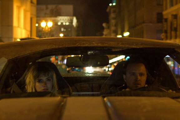 "06102914 Tobey Marshall (Aaron Paul) and Julia Maddon (Imogen Poots) have less than 45 hours to race from New York to California in DreamWorks Pictures' ""Need for Speed"", an exciting return to the great car culture films of the 1960s and '70s that tap into what makes the American myth of the open road so enticing."