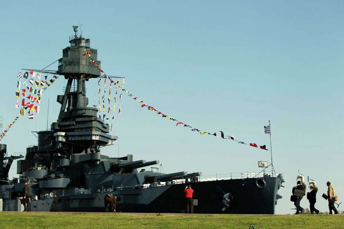 Musicians and guests arrive early for Wednesday's private crew reunion ceremony at the Battleship Texas. The public part of the celebration will be Saturday.