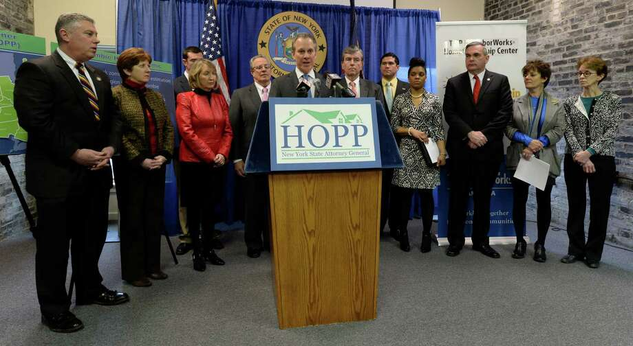 Attorney General Eric Schneiderman, joined by a number of elected officials and others, announced the statewide results of the Homeowner Protection Program during a press briefing Wednesday morning, March 12, 2014, in Troy, N.Y.      (Skip Dickstein / Times Union) Photo: SKIP DICKSTEIN / 00026110A
