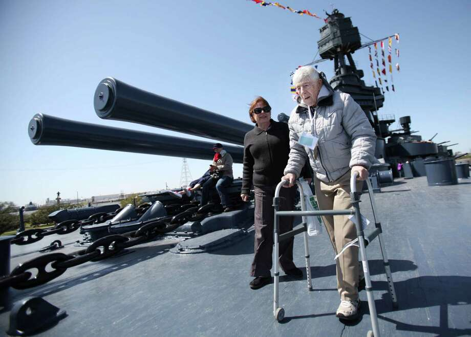WWII Veteran Albert Jackson walks the deck of USS Texas after the Crew Reunion and Centennial Commissioning Celebration on March 12, 2014, in Houston. Photo: Mayra Beltran, Houston Chronicle / © 2014 Houston Chronicle