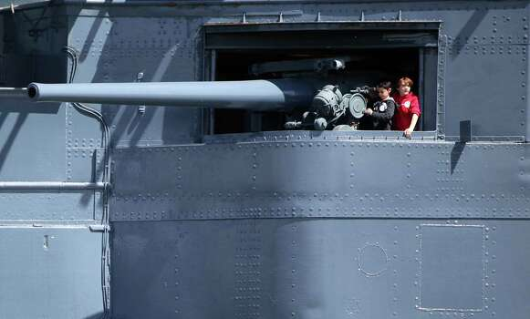 Visitors view weapons aboard the USS Texas as it observes the Battleship Texas Centennial Celebration this weekend on March 12, 2014, in Houston. Photo: Mayra Beltran, Houston Chronicle / © 2014 Houston Chronicle