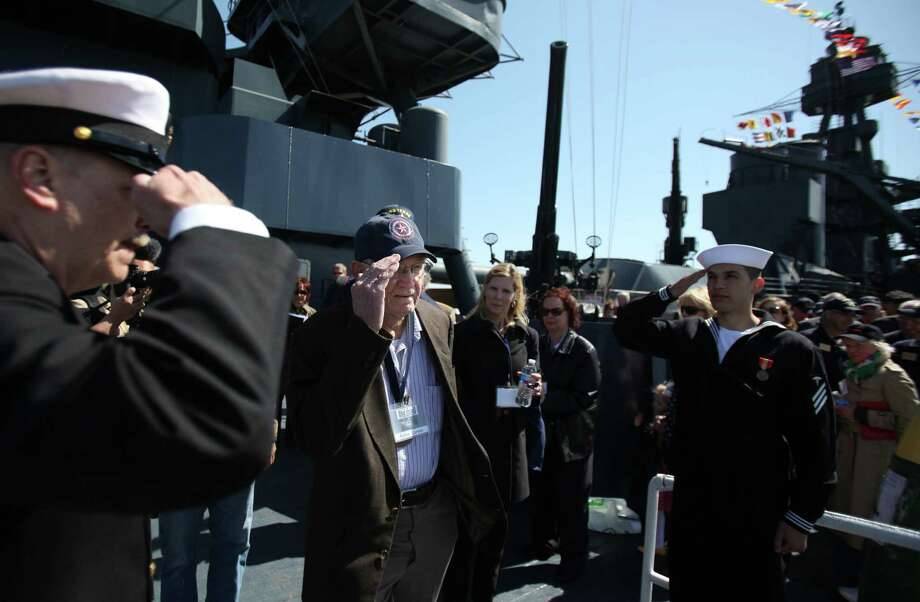 WWII Veteran Milton Lorenz is saluted upon disembarking the USS Texas after the Crew Reunion and Centennial Commissioning Celebration of the Battleship USS Texas on March 12, 2014, in Houston. Photo: Mayra Beltran, Houston Chronicle / © 2014 Houston Chronicle