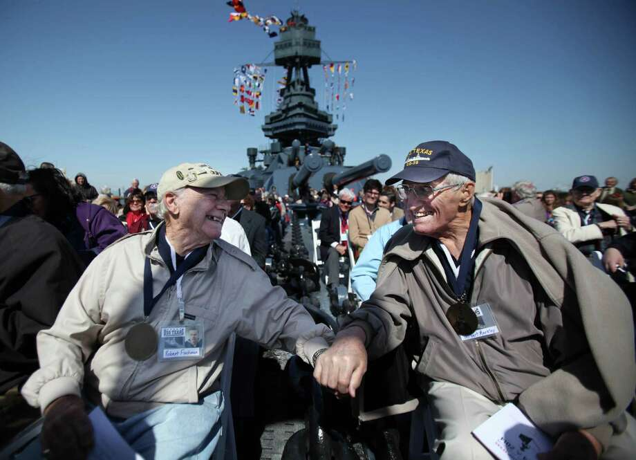 """""""It looks good on you"""" says Veteran Robert Fischman, and Veteran Herbert Markley responds """"It's about time"""" while the WWII Veterans receive a Patriot Medal during the Crew Reunion and Centennial Commissioning Celebration of the Battleship USS Texas on March 12, 2014, in Houston. Photo: Mayra Beltran, Houston Chronicle / © 2014 Houston Chronicle"""