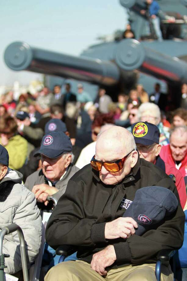 WWII Veteran John Eddleman observes a moment of silence for the fallen while the Navy Hymn played during the Crew Reunion and Centennial Commissioning Celebration of the Battleship USS Texas (BB-35) on March 12, 2014, in Houston. Photo: Mayra Beltran, Houston Chronicle / © 2014 Houston Chronicle
