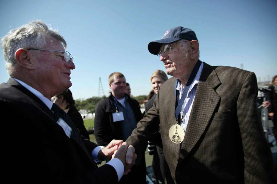 WWII Veteran Milton Lorenz receives medal from Rear Admiral Weldon Koenig during the Crew Reunion and Centennial Commissioning Celebration of the Battleship USS Texas on March 12, 2014, in Houston. Photo: Mayra Beltran, Houston Chronicle / © 2014 Houston Chronicle