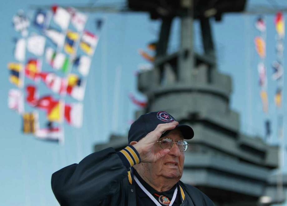 WWII Veteran Charles Ira salutes while the honor guard  presents the color during the Crew Reunion and Centennial Commissioning Celebration of the Battleship USS Texas on March 12, 2014, in Houston. Photo: Mayra Beltran, Houston Chronicle / © 2014 Houston Chronicle