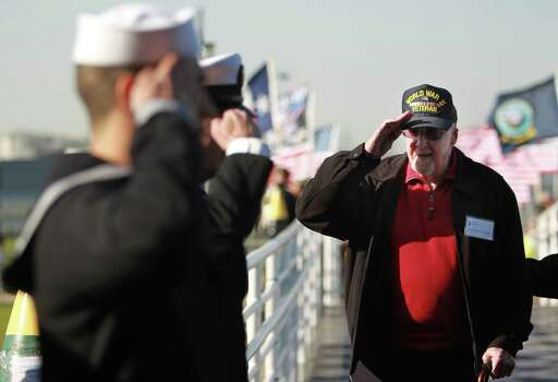 WWII veteran Edward Turner is saluted upon arrival for the private Crew Reunion which is part of the Battleship Texas Centennial Celebration on March 12, 2014, in Houston. Photo: Mayra Beltran, Houston Chronicle / © 2014 Houston Chronicle