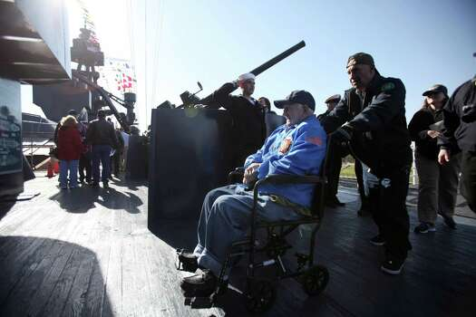 WWII Veteran Ed Borowski is saluted as he boards the USS Texas before the Crew Reunion and Centennial Commissioning Celebration on March 12, 2014, in Houston. Photo: Mayra Beltran, Houston Chronicle / © 2014 Houston Chronicle