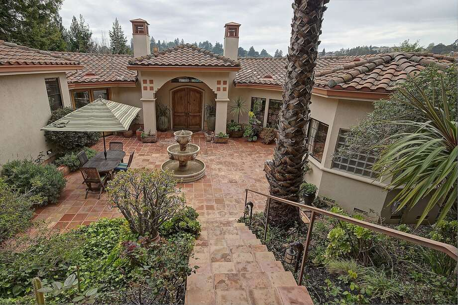 943 Aquarius Way is a four-bedroom home with a private courtyard. Photo: Bill Compton