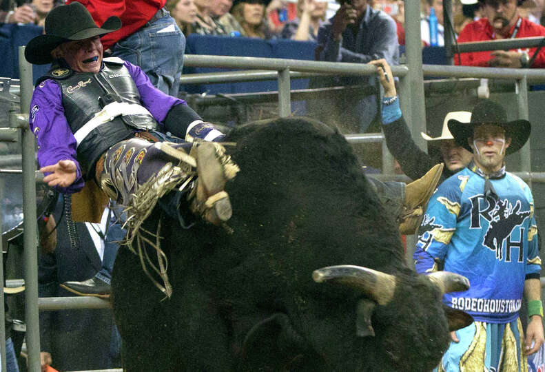 Steve Woolsey rides the bull named Escape Artist in the second round of the Rodeo Houston BP Super S