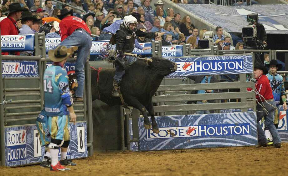 The bull Buckstop gives Trey Benton a ride in the Bull Riding event in the second round of the Rodeo Houston BP Super Series lll at the Houston Livestock Show and Rodeo at Reliant Stadium Tuesday, March 11, 2014, in Houston. Photo: Johnny Hanson, Houston Chronicle / © 2014  Houston Chronicle