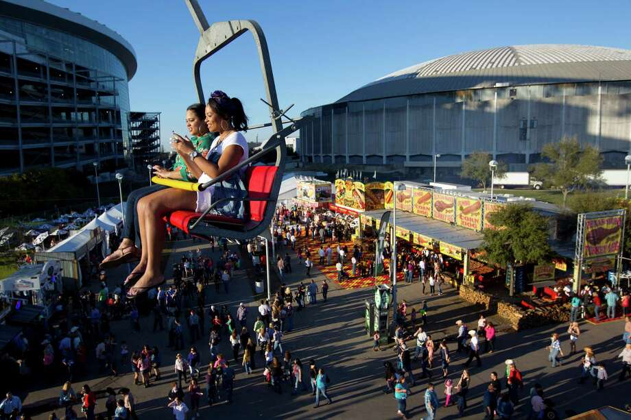 Attendees take to the air to get an overhead view from 58-feet up on the Sky Ride at the Houston Livestock Show and Rodeo carnival area at Reliant Park Tuesday, March 11, 2014, in Houston. Photo: Johnny Hanson, Houston Chronicle / © 2014  Houston Chronicle
