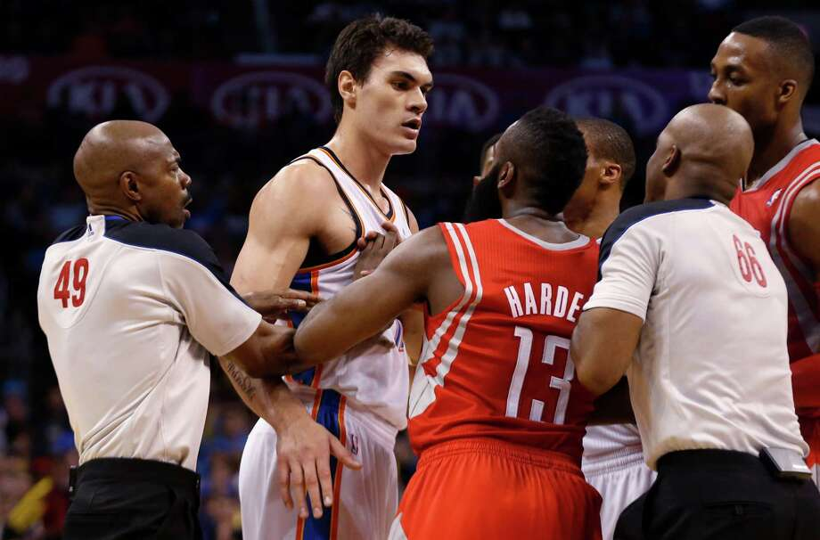 James Harden (13) takes exception to contact by the Thunder's Steven Adams, proving Tuesday's test packed playoff intensity. Photo: Sue Ogrocki, STF / AP