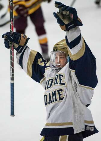 Notre Dame Fairfield high school's Jonny Suporn celebrates his team scoring a goal in the first period of a first round game of the CIAC division I boys ice hockey tournament against St. Joseph high school played at Milford Ice Pavilion, Milford, CT on Wednesday, March, 12th, 2014. Photo: Mark Conrad / Connecticut Post Freelance