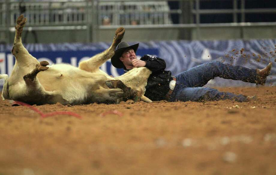Billy Bugenig wins the Steer Wrestling event during the final round of the BP Super Series lll Rodeo Houston at Reliant Stadium Wednesday, March 12, 2014, in Houston. Photo: Johnny Hanson, Houston Chronicle / © 2014  Houston Chronicle
