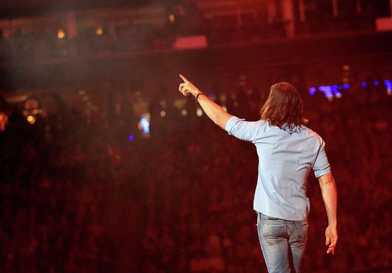 Jake Owen performs during Rodeo Houston at Reliant Stadium Wednesday, March 12, 2014, in Houston.