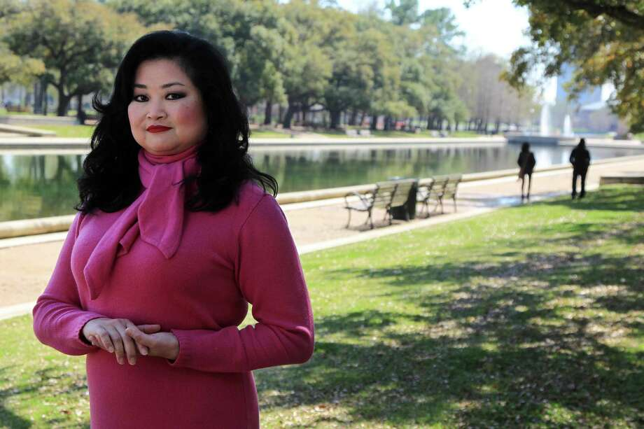Gigi Huang, photographed at Hermann Park Reflecting Pool, is the new marketing manager for the upcoming Yauatcha restaurant opening in the Galleria in late March 2017. Photo: Mayra Beltran, Houston Chronicle / © 2014 Houston Chronicle