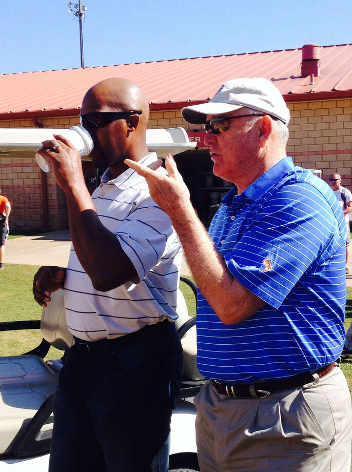 New Astros adviser Nolan Ryan (right), watching workouts with manager Bo Porter, sees similarities to the '08 Rangers. Photo: Jose De Jesus Ortiz / Houston Chronicle