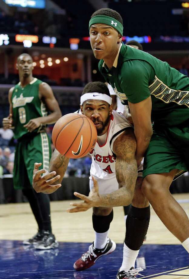 Rutgers forward J. J. Moore (44) and South Florida forward Zach LeDay, right, collide while going for a rebound in the second half of an NCAA college basketball game at the American Athletic Conference men's tournament Wednesday, March 12, 2014, in Memphis, Tenn. Rutgers won 72-68. (AP Photo/Mark Humphrey) ORG XMIT: TNMH114 Photo: Mark Humphrey / AP