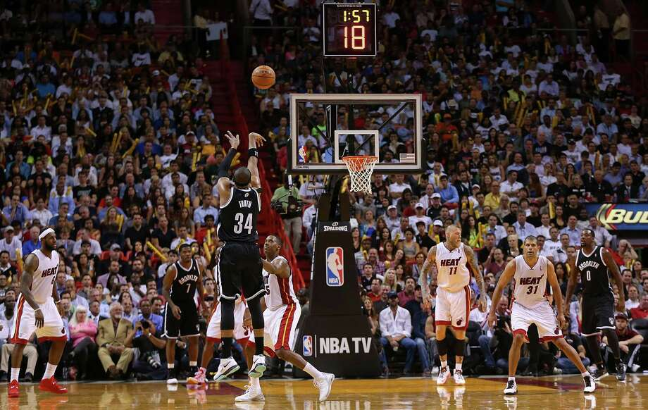 MIAMI, FL - MARCH 12: Paul Pierce #34 of the Brooklyn Nets shoots over Mario Chalmers #15 of the Miami Heat during a game  at American Airlines Arena on March 12, 2014 in Miami, Florida. NOTE TO USER: User expressly acknowledges and agrees that, by downloading and/or using this photograph, user is consenting to the terms and conditions of the Getty Images License Agreement. Mandatory copyright notice:  (Photo by Mike Ehrmann/Getty Images) ORG XMIT: 182421917 Photo: Mike Ehrmann / 2014 Getty Images