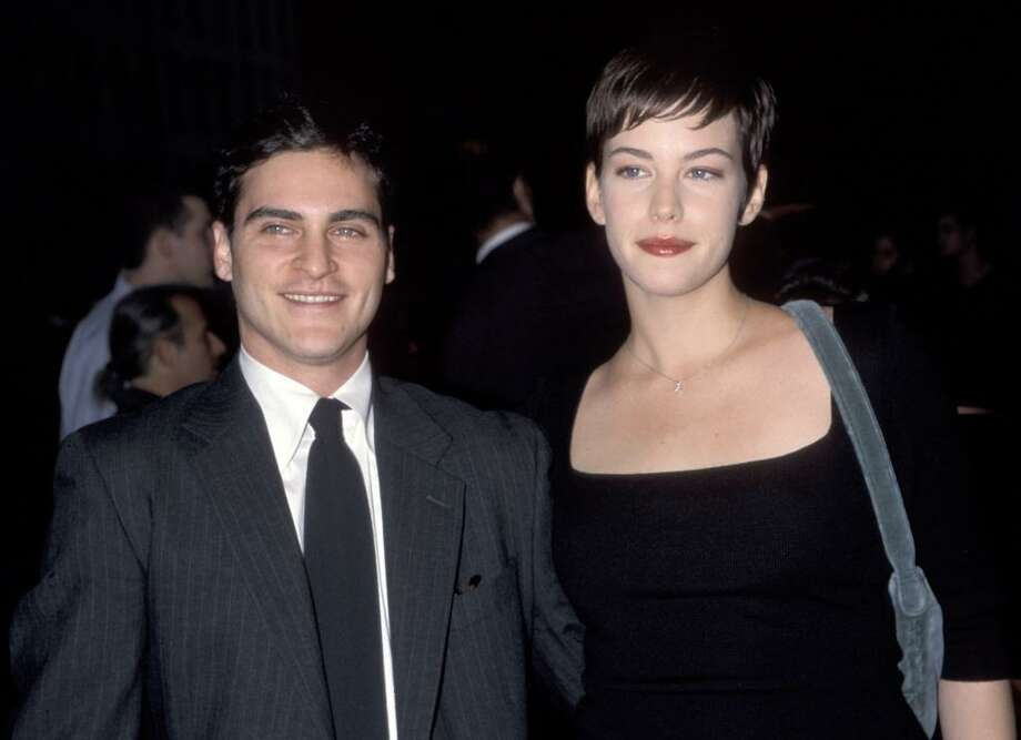 """Joaquin Phoenix and Liv Tyler met on the set of the 1995 film """"Inventing the Abbots"""" and fell in love, moving in together during their three-year romance. Tyler said of meeting Phoenix, """"I fell in love with Joaquin the second I saw him."""" Photo: Ron Galella, Ltd., WireImage"""