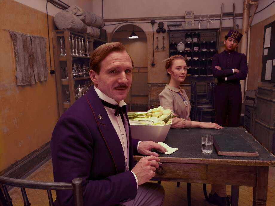 RALPH FIENNES, SAOIRSE RONAN and TONY REVOLORI in The Grand Budapest Hotel, directed by Wes Anderson. DSC01930.ARW Photo: Fox Searchlight
