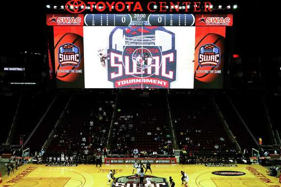 The opening tipoff between TSU and Grambling is shown on the video screen during the first half of a SWAC basketball tournament quarterfinal game, Wednesday, March 12, 2014, at Toyota Center in Houston. (Photo: Eric Christian Smith/For the Chronicle)